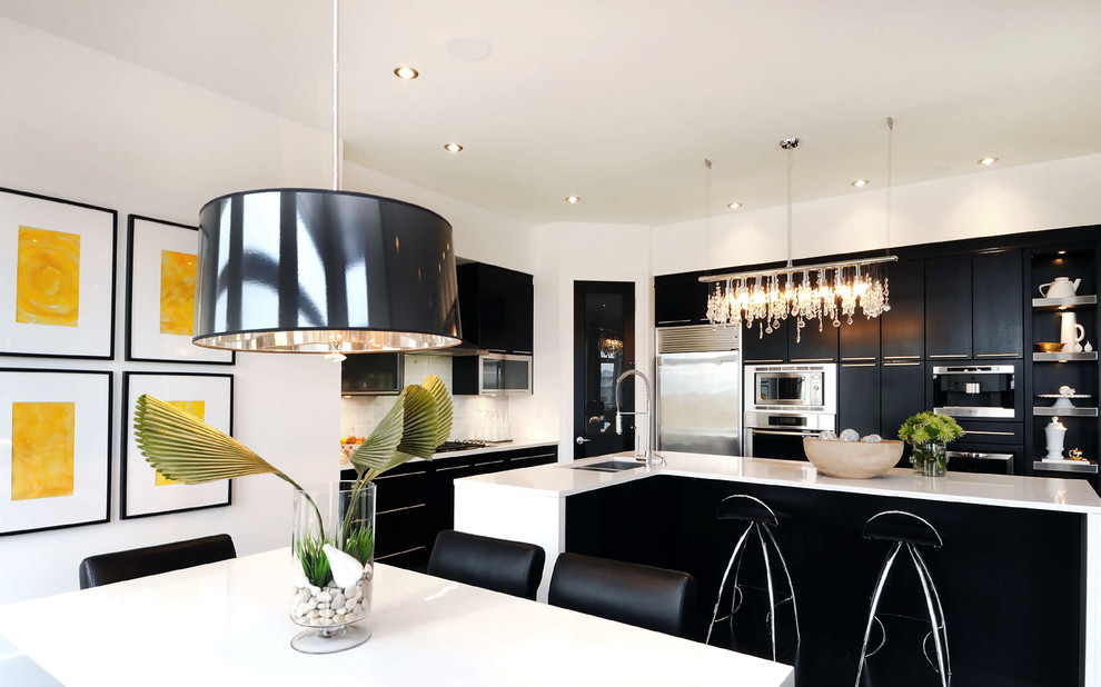Example of a trendy eat-in kitchen design in Other with stainless steel appliances, an undermount sink, flat-panel cabinets and black cabinets