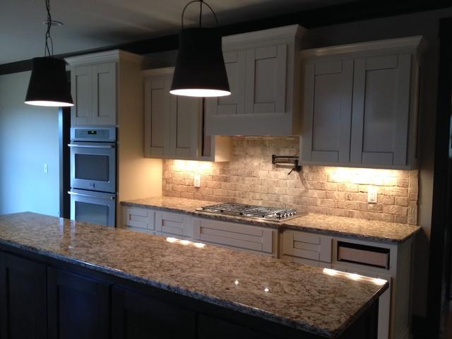 Willson Custom Home Plan Kitchen at brick backsplash install