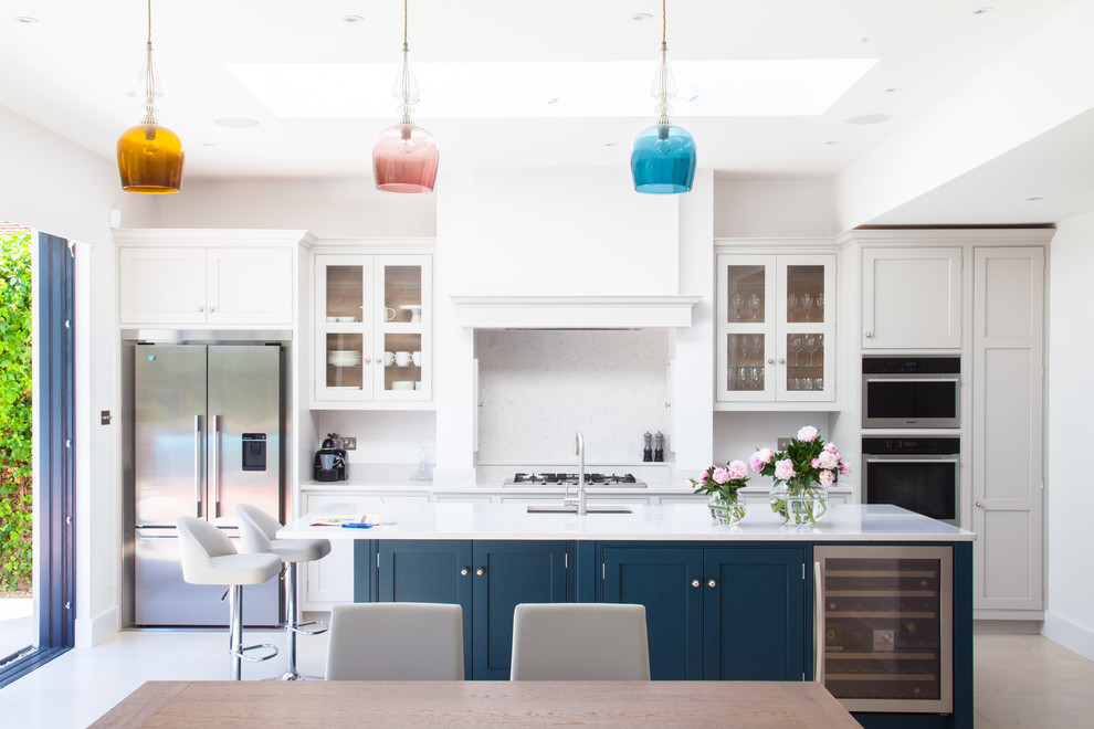 Inspiration for a large timeless open concept kitchen remodel in London with quartzite countertops and an island