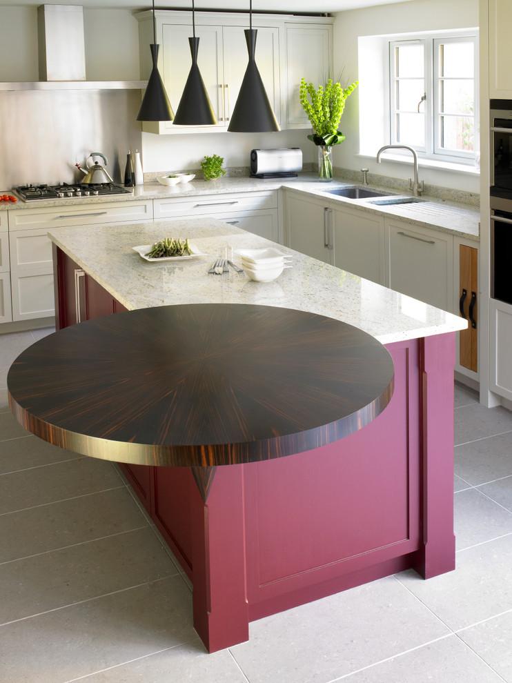 Kitchen - contemporary u-shaped kitchen idea in London with an undermount sink, shaker cabinets, granite countertops, metallic backsplash, metal backsplash, stainless steel appliances and white cabinets