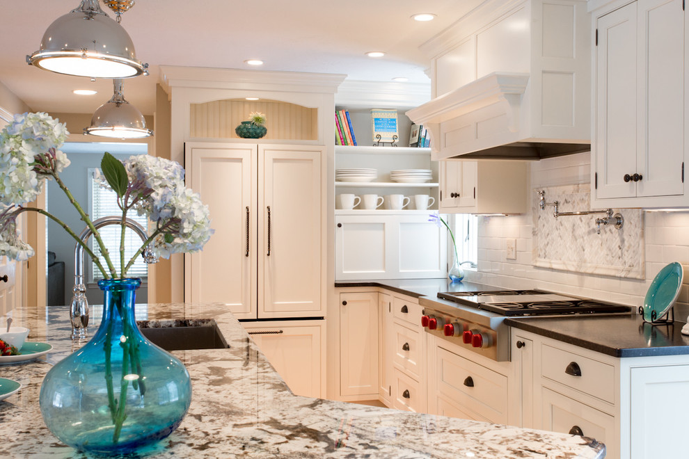 Inspiration for a mid-sized timeless medium tone wood floor and beige floor kitchen remodel in Boston with granite countertops, a single-bowl sink, shaker cabinets, white cabinets, white backsplash, subway tile backsplash, stainless steel appliances and an island