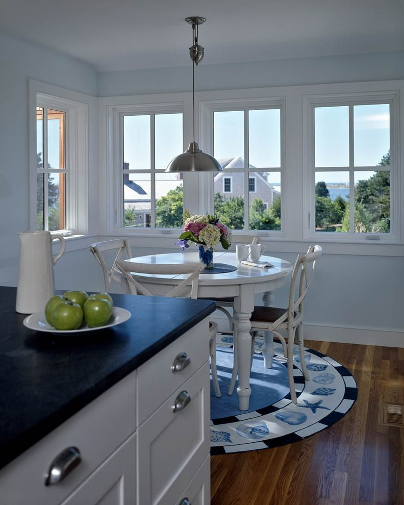 Example of a classic kitchen design in Boston with stainless steel appliances
