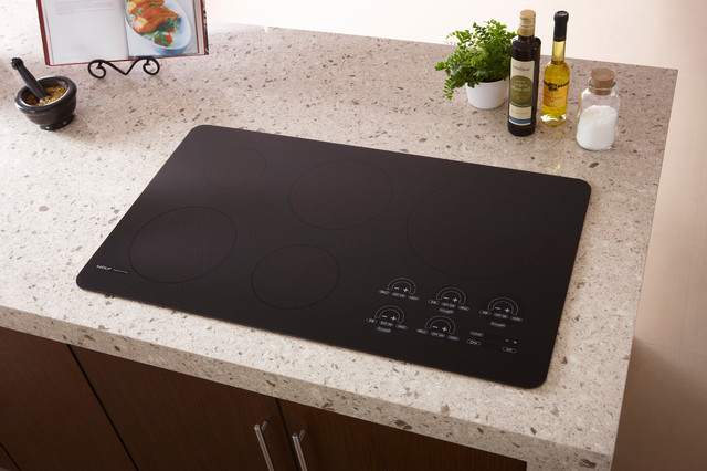 Wolf 36 induction cooktop black unframed ct36iu for Stove top with built in vent