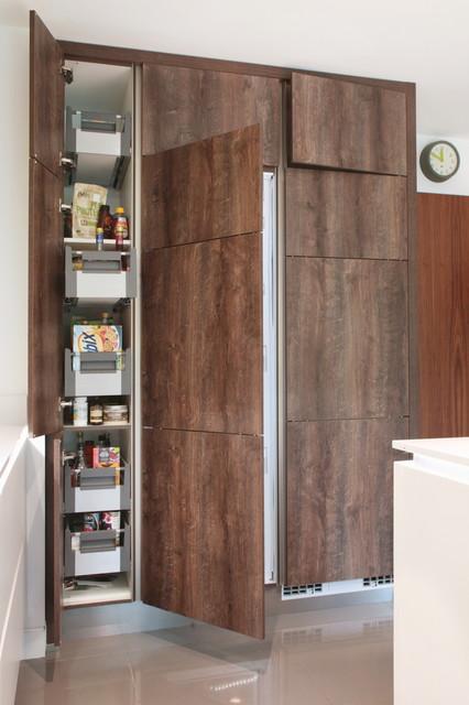 Wood effect matt kitchen with tall storage units for Wood effect kitchen units