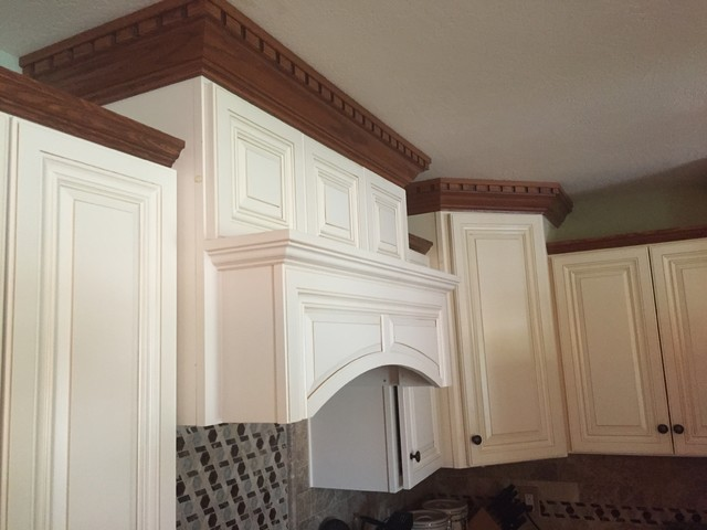 Wood Hood Staggered Wall Cabinets And Crown Moulding