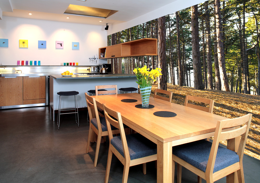 Example of a trendy eat-in kitchen design in Other with flat-panel cabinets and medium tone wood cabinets