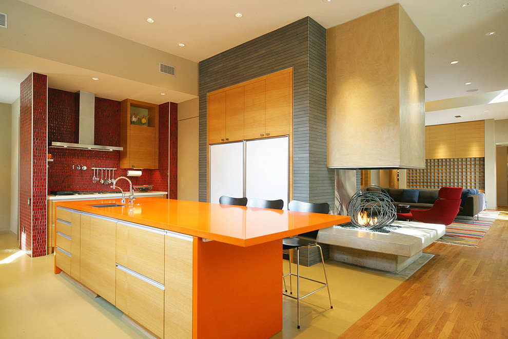 Trendy kitchen photo in Dallas with red backsplash and orange countertops