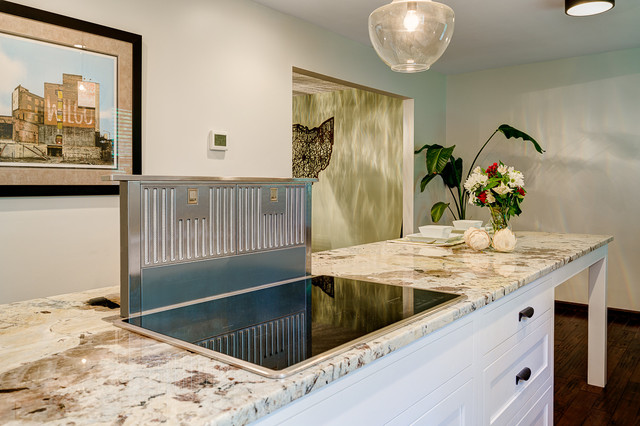 Example of a mid-sized classic galley medium tone wood floor eat-in kitchen design in Columbus with a double-bowl sink, shaker cabinets, white cabinets, granite countertops, white backsplash, subway tile backsplash, stainless steel appliances and an island