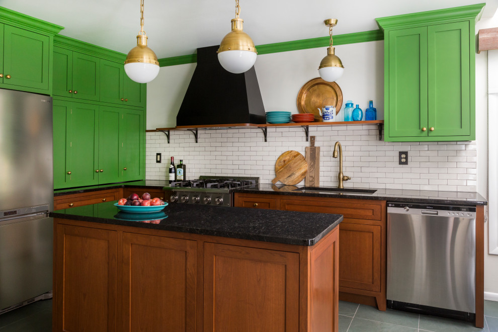Inspiration for a mid-sized eclectic l-shaped slate floor and green floor eat-in kitchen remodel in Philadelphia with an undermount sink, shaker cabinets, green cabinets, granite countertops, white backsplash, ceramic backsplash, stainless steel appliances, an island and black countertops