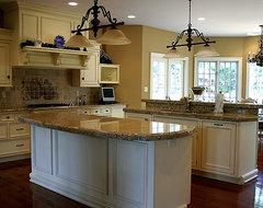 Cream kitchen cupboards with white trim