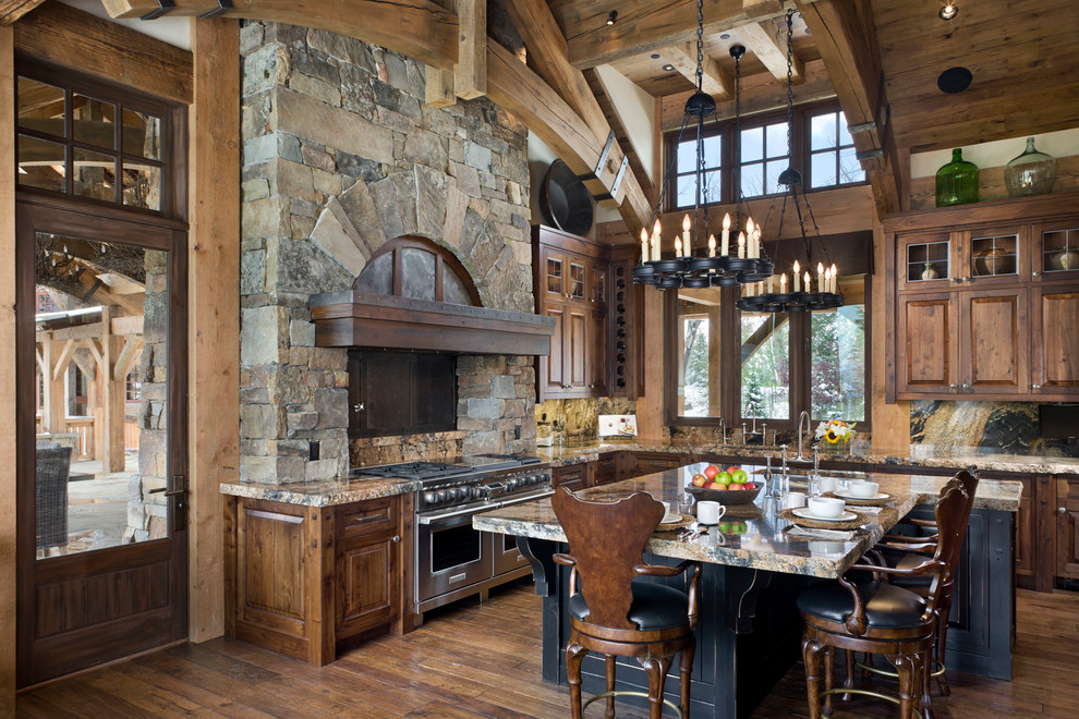 Kitchen - rustic kitchen idea in Other with raised-panel cabinets, stainless steel appliances and dark wood cabinets