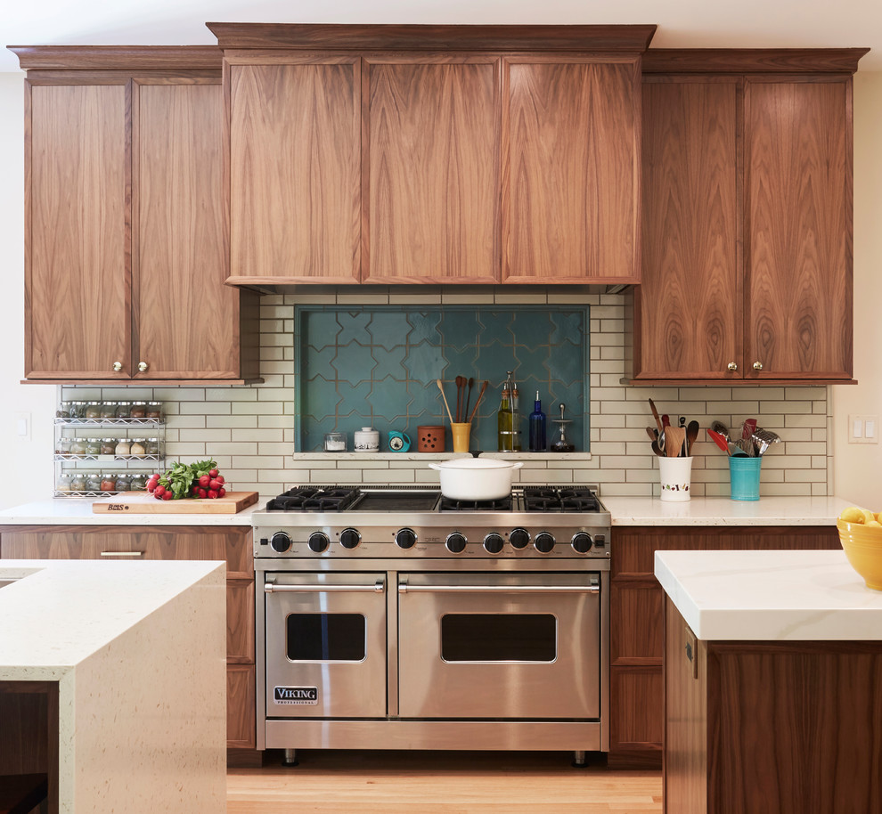 Inspiration for a transitional galley light wood floor and beige floor eat-in kitchen remodel in Chicago with medium tone wood cabinets, quartz countertops, beige backsplash, subway tile backsplash, two islands, white countertops and recessed-panel cabinets