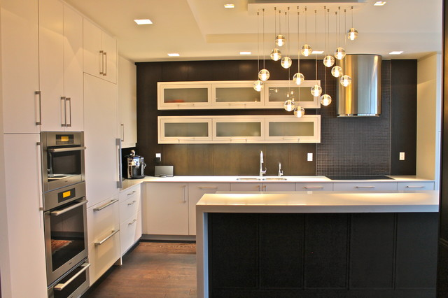 Example Of A Trendy L Shaped Kitchen Design In Toronto With Flat Panel  Cabinets