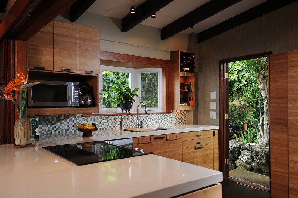 Example of a mid-sized island style u-shaped eat-in kitchen design in Hawaii with an undermount sink, flat-panel cabinets, medium tone wood cabinets, quartzite countertops, green backsplash, mosaic tile backsplash and stainless steel appliances