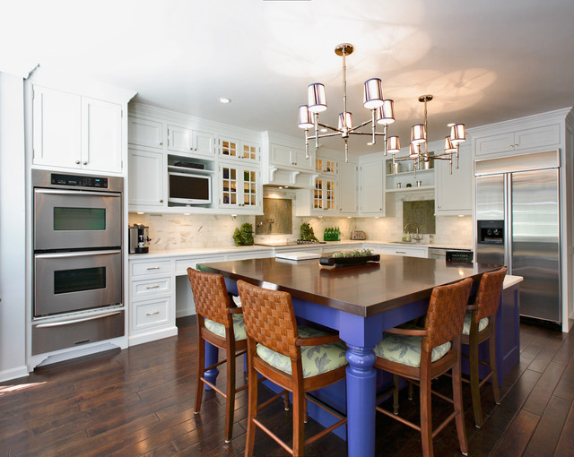 Example Of A Transitional L Shaped Kitchen Design In New York With  Stainless Steel Appliances
