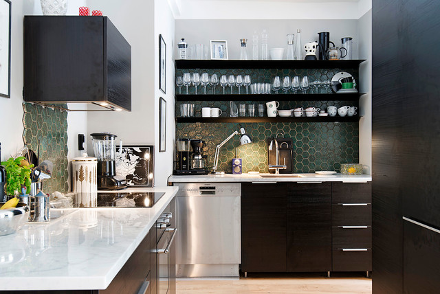 Large danish l-shaped light wood floor enclosed kitchen photo in Stockholm with an undermount sink, flat-panel cabinets, black cabinets, green backsplash, stainless steel appliances, no island and marble countertops