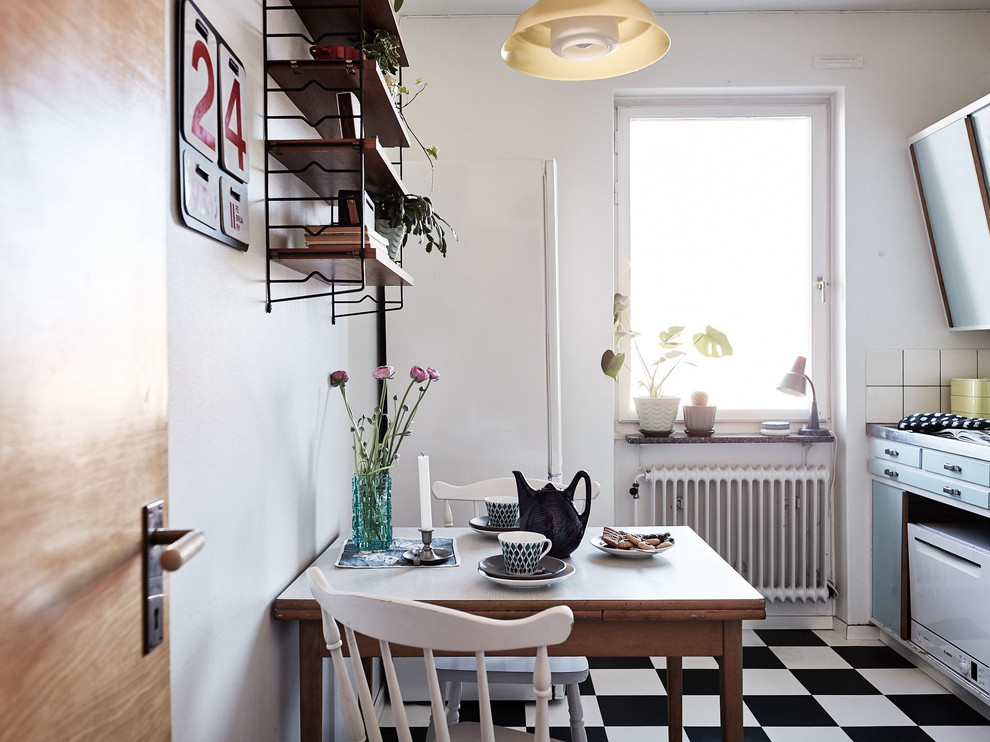Small danish single-wall ceramic tile eat-in kitchen photo in Stockholm with flat-panel cabinets, blue cabinets and no island