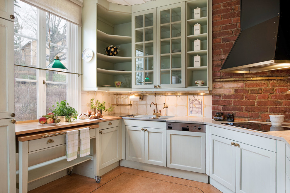 Enclosed kitchen - mid-sized farmhouse single-wall enclosed kitchen idea in Stockholm with a double-bowl sink, glass-front cabinets, green cabinets, marble countertops and no island