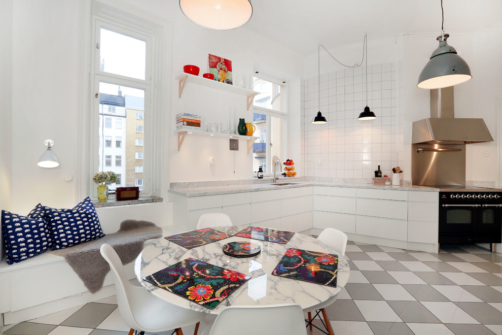 Small eclectic single-wall ceramic floor eat-in kitchen photo in Stockholm with flat-panel cabinets, white cabinets, marble countertops, white backsplash, ceramic backsplash, black appliances and no island