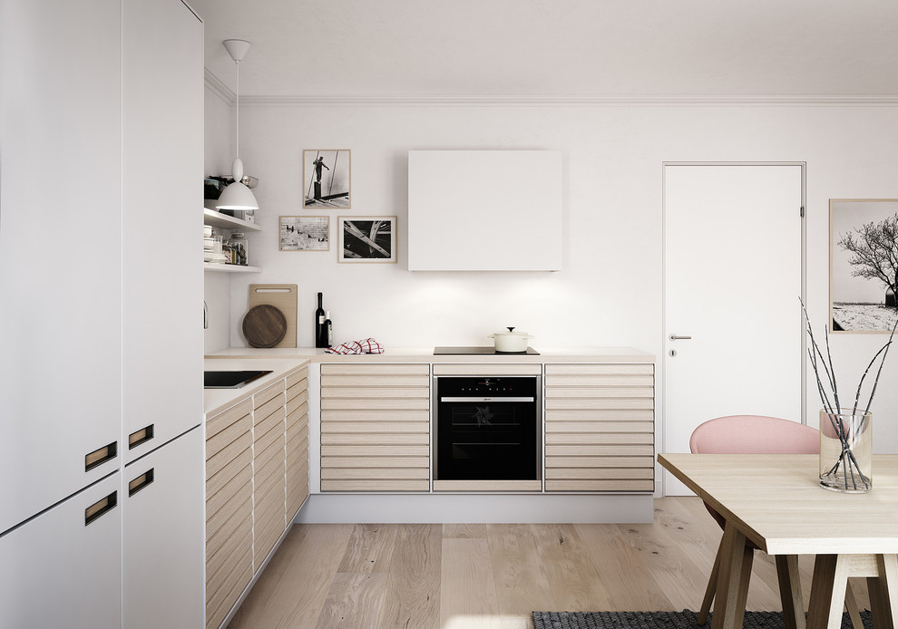 Example of a mid-sized danish l-shaped light wood floor eat-in kitchen design in Esbjerg with a drop-in sink, beaded inset cabinets, light wood cabinets, laminate countertops, stainless steel appliances and no island