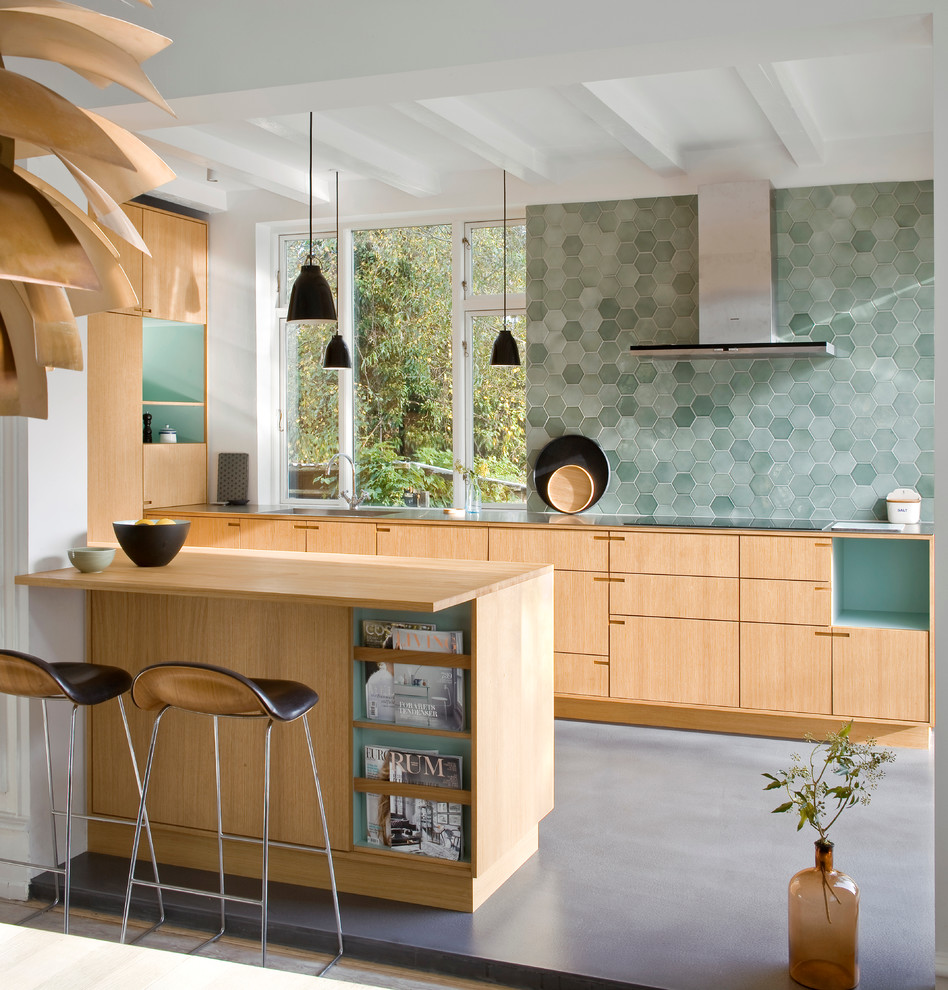 Inspiration for a mid-sized scandinavian galley linoleum floor eat-in kitchen remodel in Copenhagen with flat-panel cabinets, light wood cabinets, green backsplash, a peninsula, a drop-in sink and wood countertops