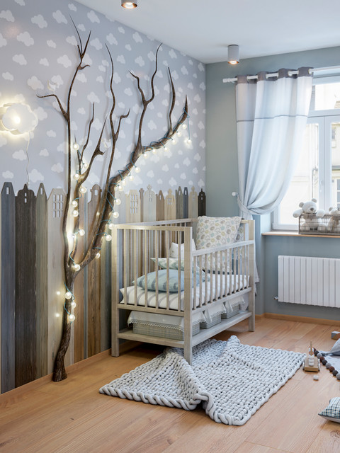 Inspiration for a transitional gender-neutral light wood floor and beige floor nursery remodel in Other with multicolored walls