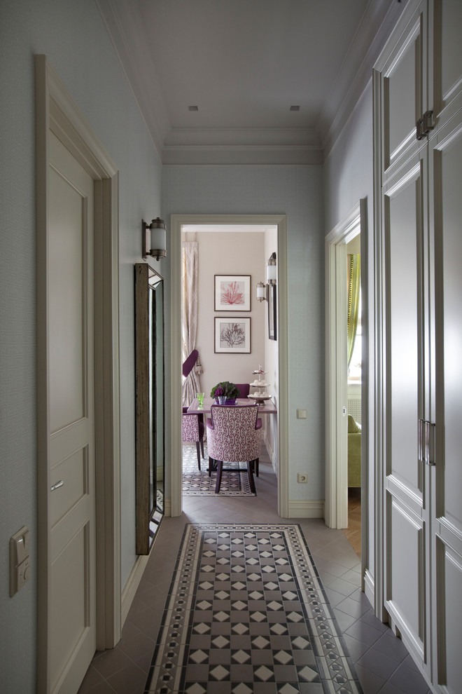 Hallway - traditional ceramic tile hallway idea in Moscow with white walls