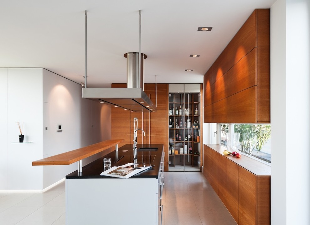 Open concept kitchen - mid-sized contemporary open concept kitchen idea in Munich with an undermount sink, flat-panel cabinets, medium tone wood cabinets, paneled appliances and an island