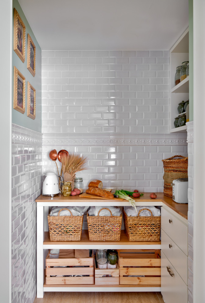 Example of a transitional kitchen pantry design in Other
