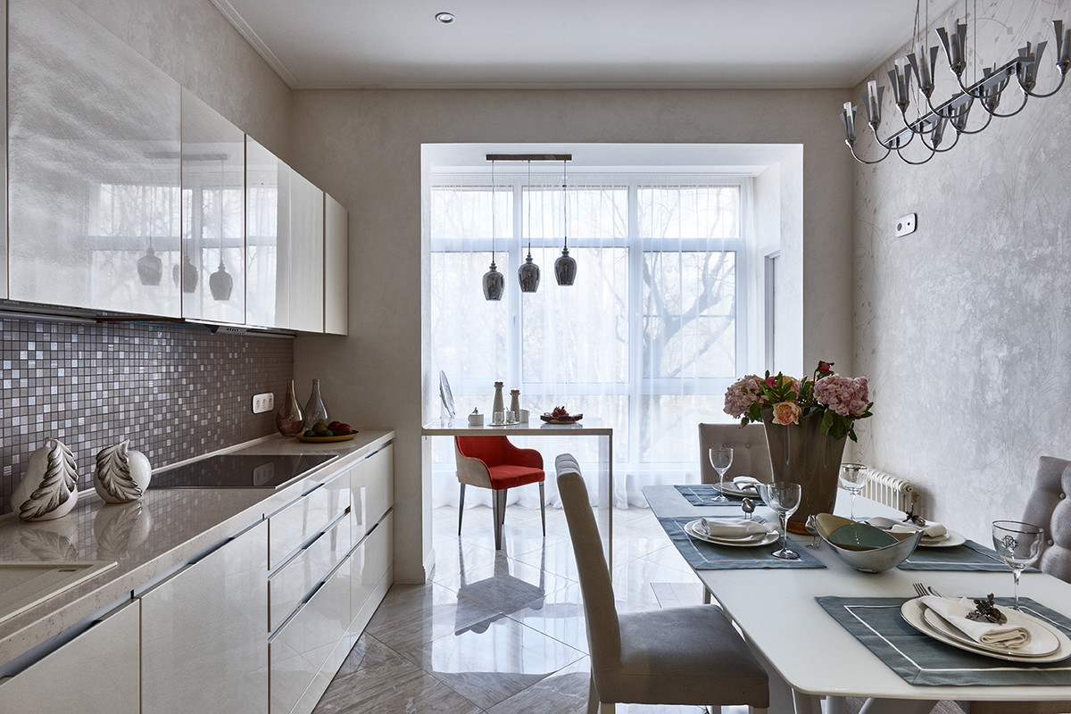 Example of a trendy l-shaped eat-in kitchen design in Moscow with flat-panel cabinets, beige cabinets, gray backsplash, mosaic tile backsplash and no island