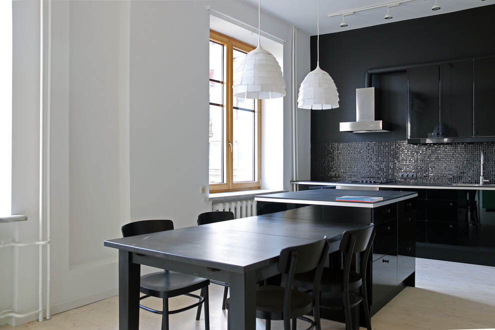 Small trendy galley light wood floor open concept kitchen photo in Moscow with a drop-in sink, flat-panel cabinets, black cabinets, laminate countertops, black backsplash, mosaic tile backsplash, stainless steel appliances and an island