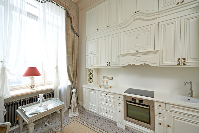 Elegant single-wall enclosed kitchen photo in Moscow with a drop-in sink, raised-panel cabinets, white cabinets, white backsplash, stainless steel appliances and no island