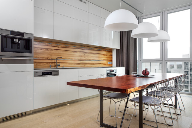 Eat-in kitchen - mid-sized contemporary single-wall light wood floor eat-in kitchen idea in Saint Petersburg with an undermount sink, flat-panel cabinets, white cabinets, quartz countertops, no island, brown backsplash and stainless steel appliances