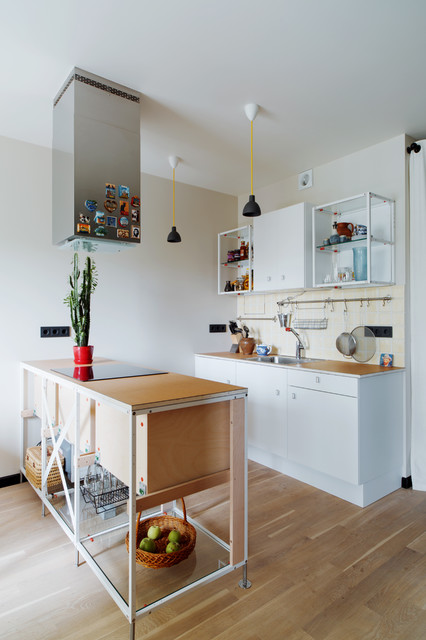 Example of a trendy galley medium tone wood floor kitchen design in Moscow with open cabinets, white cabinets and an island