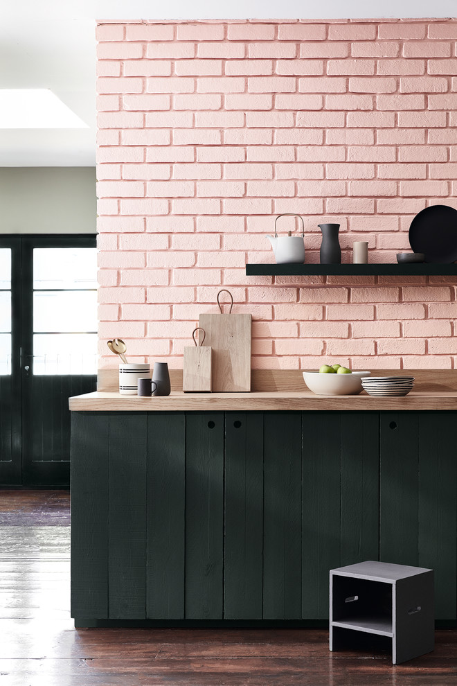 Eclectic dark wood floor and brown floor kitchen photo in Moscow with flat-panel cabinets, black cabinets, wood countertops, pink backsplash and brick backsplash