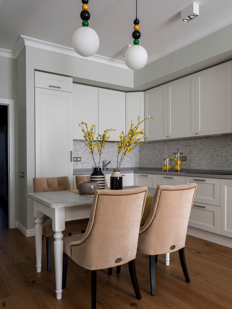 Transitional l-shaped medium tone wood floor and brown floor eat-in kitchen photo in Moscow with recessed-panel cabinets, white cabinets, gray backsplash, mosaic tile backsplash, no island and gray countertops