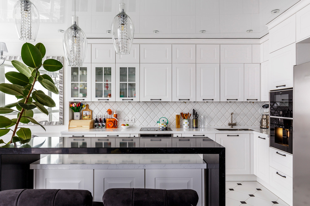 Danish l-shaped white floor kitchen photo in Moscow with an undermount sink, white backsplash, black appliances, an island and raised-panel cabinets