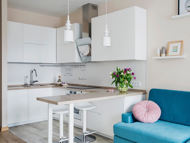 Danish u-shaped open concept kitchen photo in Moscow with a drop-in sink, flat-panel cabinets, white cabinets, white backsplash, white appliances and no island