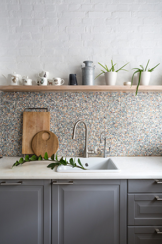 Inspiration for a contemporary single-wall kitchen remodel in Moscow with a drop-in sink, raised-panel cabinets, gray cabinets, multicolored backsplash and mosaic tile backsplash