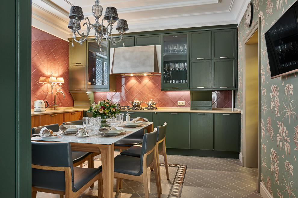 This is an example of a traditional l-shaped enclosed kitchen in Other with a submerged sink, flat-panel cabinets, green cabinets, no island and grey floors.