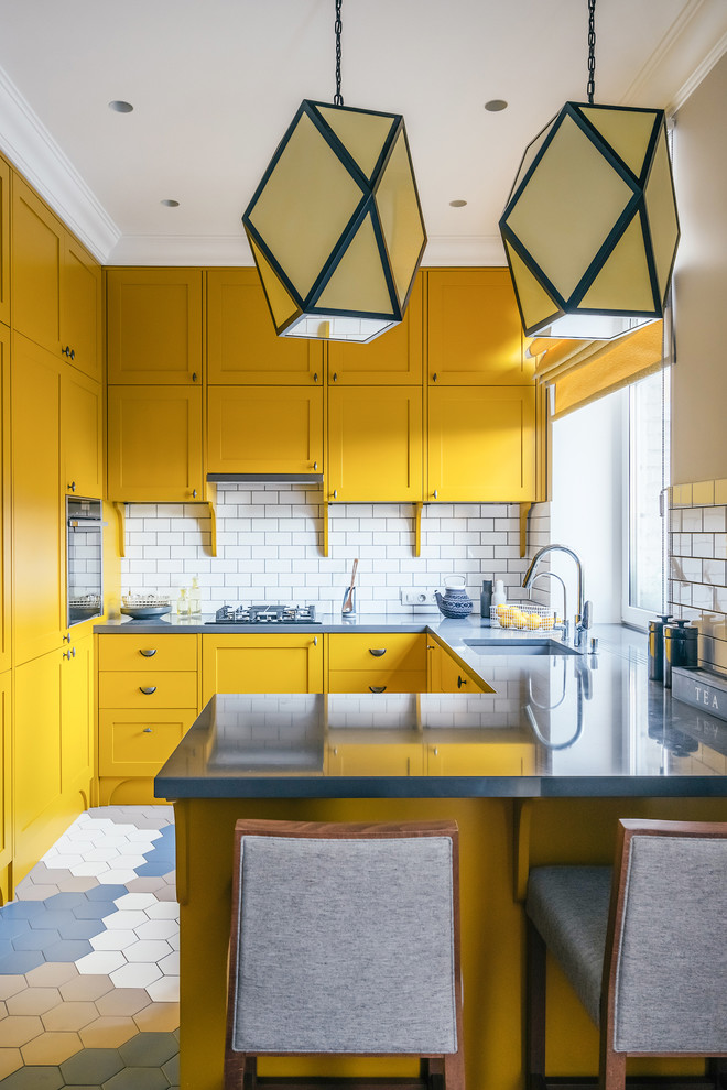 Inspiration for a contemporary u-shaped open concept kitchen remodel in Moscow with an undermount sink, recessed-panel cabinets, yellow cabinets, white backsplash, black appliances and a peninsula