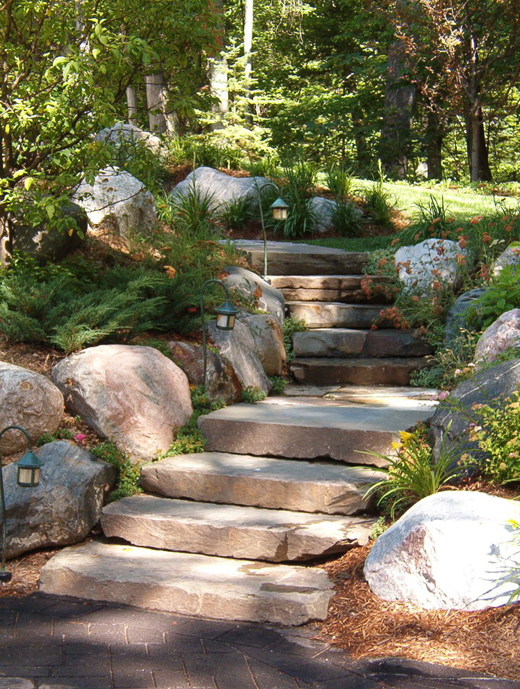 Photo of a traditional hillside stone landscaping in Other.