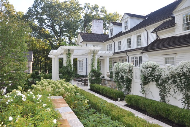 A classic country white garden traditional landscape for Classic home designs inc