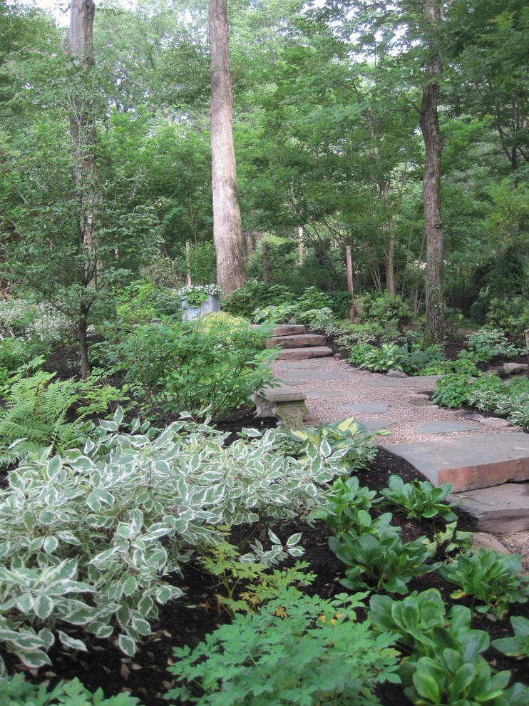 This is an example of a traditional shade backyard landscaping in New York.