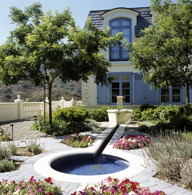 A Formal Garden with a Fountain & Rill traditional-landscape