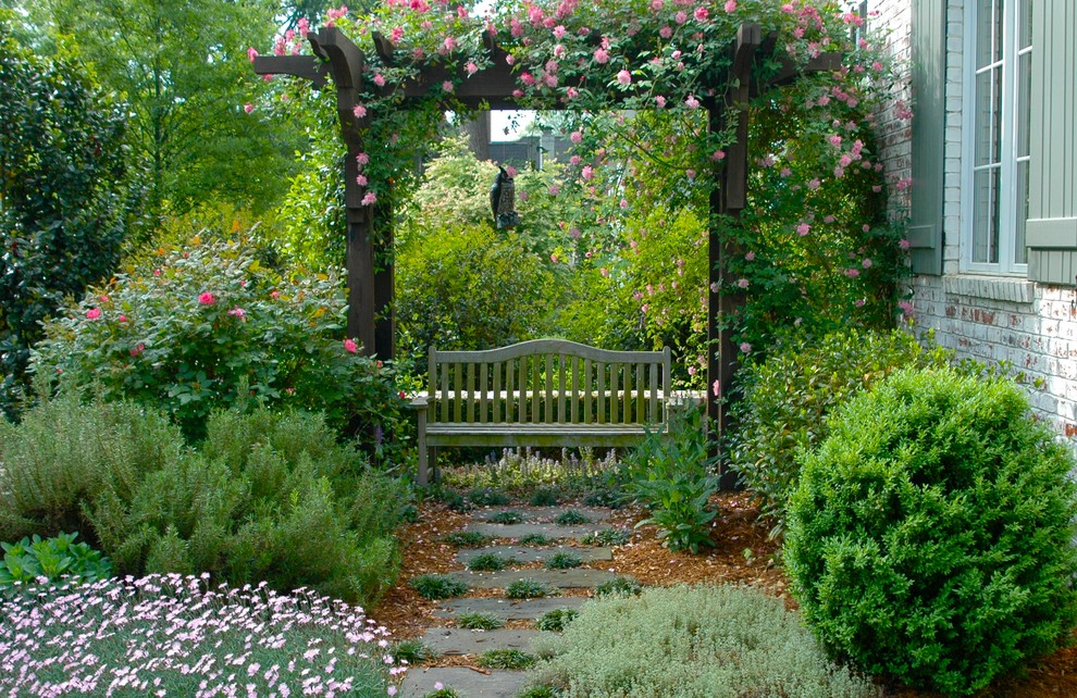 Design ideas for a mid-sized traditional backyard stone formal garden in Charlotte for summer.