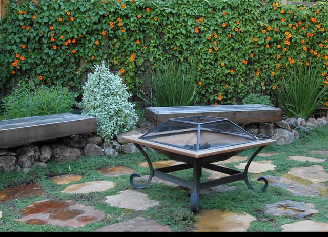 A Gardener's paradise for Outdoor Living in Suburbs mediterranean-landscape