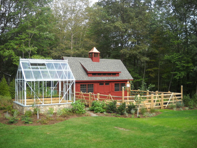 A greenhouse barn and vegetable garden