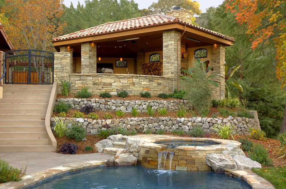 Design ideas for a large mediterranean partial sun hillside stone landscaping in San Francisco.