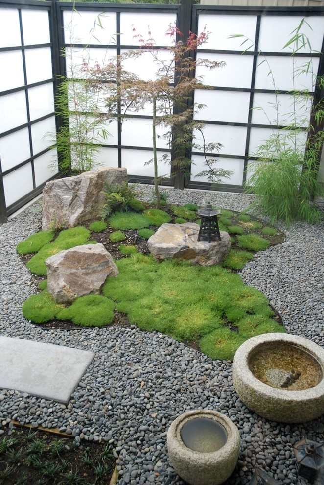 Photo of a small asian courtyard gravel water fountain landscape.